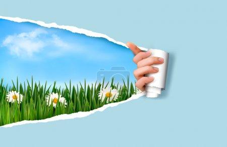 fond de nature avec l'herbe verte et ciel et papier déchiré. vec