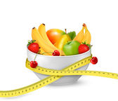 Diet meal Fruit in a bowl with measuring tape Concept of diet