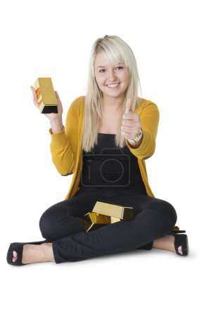 Woman with gold bars giving thumbs up