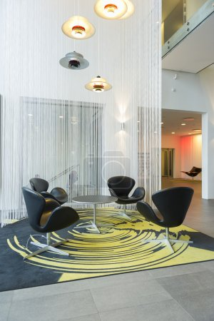 Modern table and chairs in an atrium