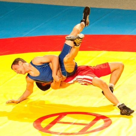 BUCHAREST, ROMANIA - JULY 25: Unidentified wrestlers fight durin