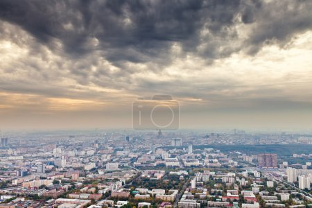 Dark yellow gray clouds under autumn Moscow