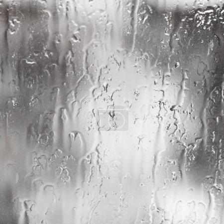 rain streams on window