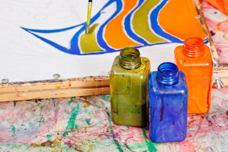 painting and bottles with dyes