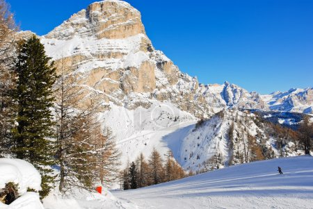 Skiing tracks and slope of Dolomites mountains