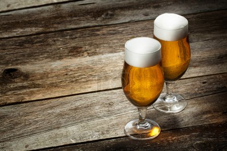 Photo for Two glass beer on wood background with copyspace - Royalty Free Image