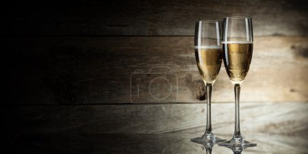 Photo for Two glass with champagne on a wooden background - Royalty Free Image