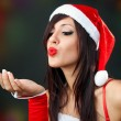 Portrait of beautiful sexy girl wearing santa clau...