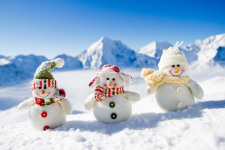 Photo for Winter, Christmas - happy snowman friends, snowy mountains in background - Royalty Free Image