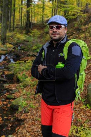 Autumn trek - man on mountain hike