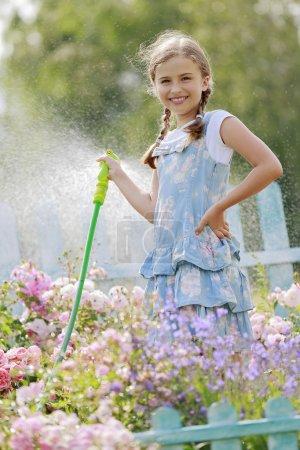 Summer fun, girl watering flowers