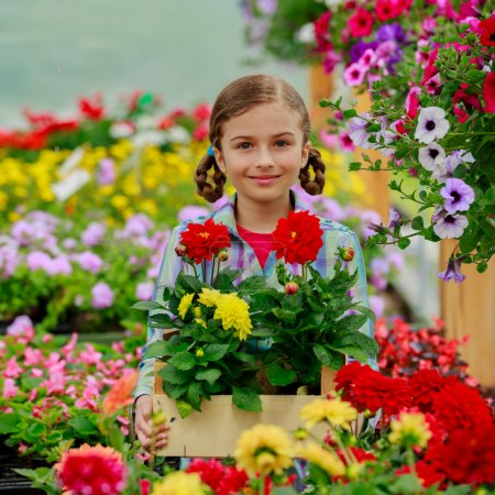 Planting, garden flowers - Lovely girl with flowers