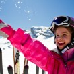 Skier, skiing, winter sport - portrait of happy gi...