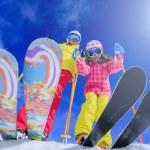 Ski, skiers, sun and winter fun - skiers enjoying ...