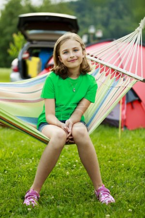 Summer in the tent - young girl with family on the camping