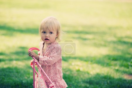 Photo for Little girl with pram - Royalty Free Image