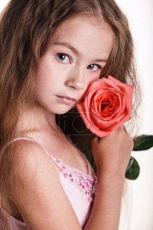 Photo for Emotional kid with lovely pink rose isolated on white - Royalty Free Image