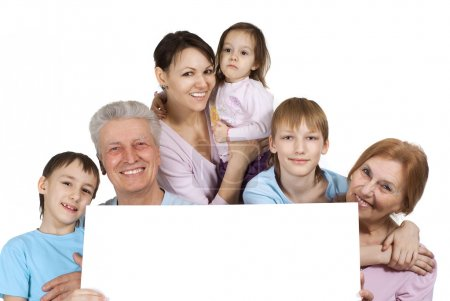 Happy Caucasian family of six holding the paper