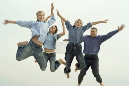 joyful family jumping