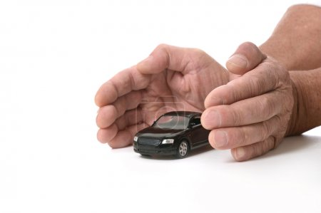 Hands with miniature car
