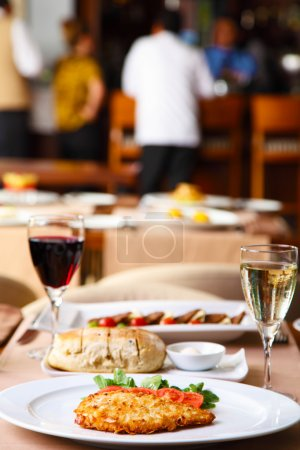Luxury restaurant table with dinner served