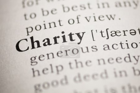 Photo pour Faux dictionnaire, dictionnaire définit le mot charité. - image libre de droit