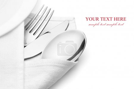 Photo for Knife, fork and spoon with linen serviette, isolated on the white background, clipping path included. - Royalty Free Image
