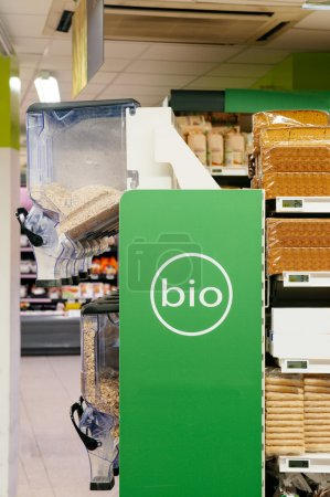 Photo for Organic food (bio) aisle displayed in a modern supermarket. Breakfast cereals and bread for a healthy eating. - Royalty Free Image