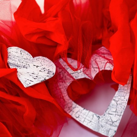 Photo for Valentine's love garland closeup with two hearts - Royalty Free Image