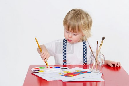 Photo for Cute toddler drawing with colorful water painting - Royalty Free Image