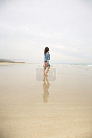 Jeans jacket woman reflect on sea