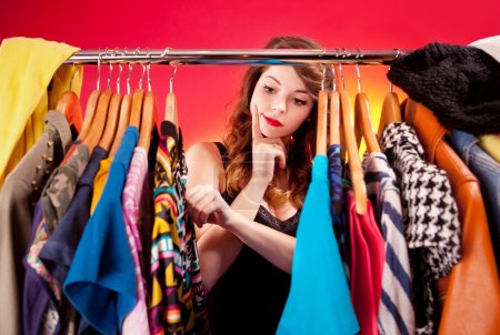 Photo for Nothing to wear concept, young woman deciding what to put on - Royalty Free Image
