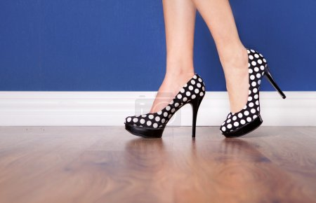 Woman wearing polka dot high heels