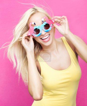 Beautiful young girl wearing sunglasses