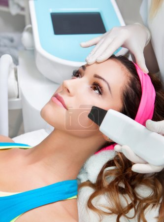 Woman getting laser face treatment