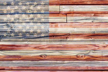 Photo for Old Painted American Flag on Dark Wooden Fence - Royalty Free Image