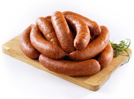 Sausage on kitchen board