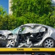 Постер, плакат: Crashed luxury car parked on a tow truck