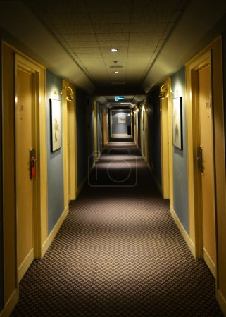 corridor in hotel with rooms entrances