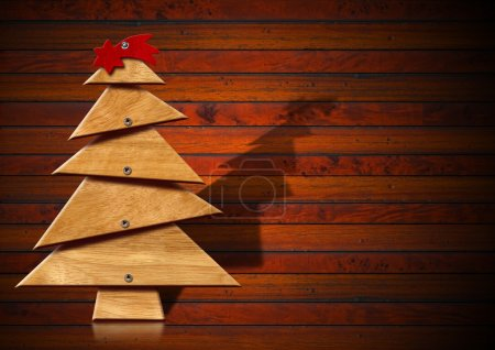 Photo for Wooden Christmas tree with screws and red comet on wood background - Royalty Free Image