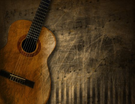 Acoustic Guitar on Grunge Background