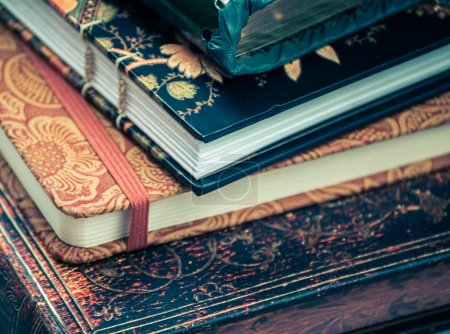 A pile of various beautiful journals and diaries...