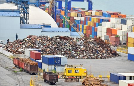 Scrap metal, container and timber in port