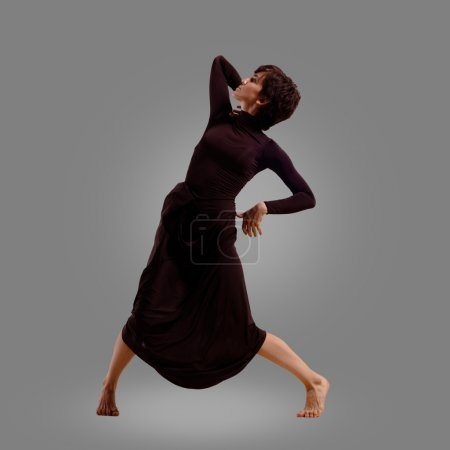 Dancing woman on grey background