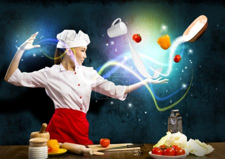 Photo for Magician chef cook in the kitchen, preparing with magic - Royalty Free Image
