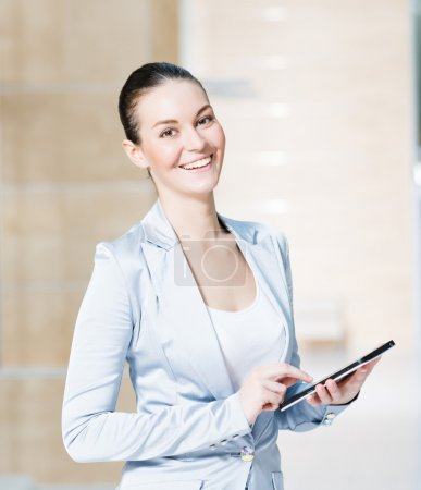 Business woman with tablet pc