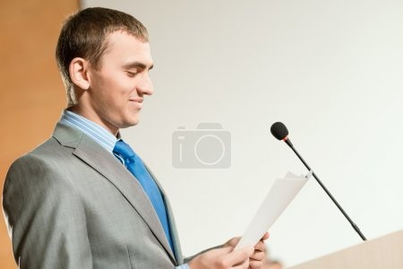Portrait of a business man with microphone