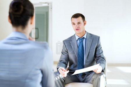 Photo for Businessman talking to a woman for a job, interviewing - Royalty Free Image