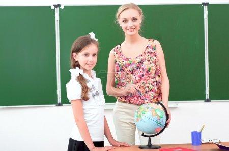 teacher and the schoolgirl in the classroom