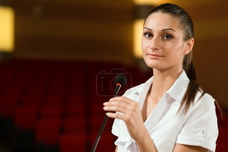 Portrait of a business woman with microphone